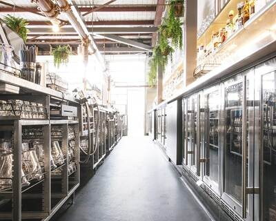 Organised commercial kitchen with racking and fridges