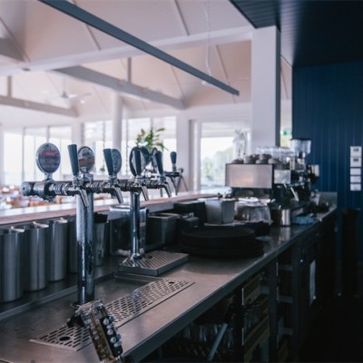 stainless steel commercial bar with beer taps