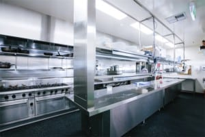 Stainless steel commercial kitchen with gas stoves